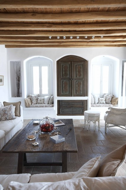 Interior of a luxurious villa in Mykonos, Greece - I love the twin window seats (via Cycladic Villa in Greece)