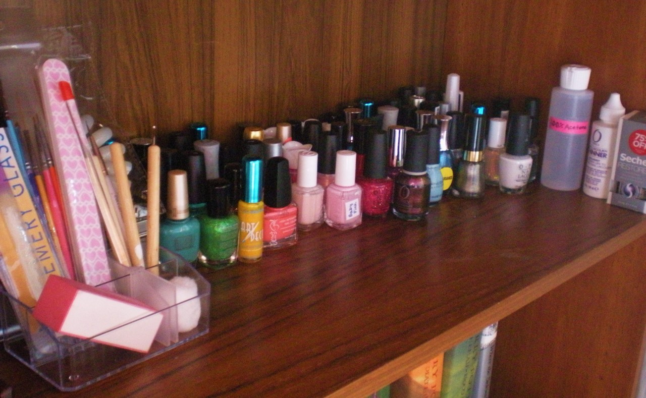 Here is how I store my nail polish and supplies. This is one book shelf, filled about 7/8 of the way with nail supplies, the last 1/8 is jewelry.  I have a total of (I think) 71 bottles of polish, and this isn't my entire collection.  I have them organized in a rainbow. :) If you have any questions about what is on my shelf, feel free to message me! Hope Y'all are having a lovely day, Gaby