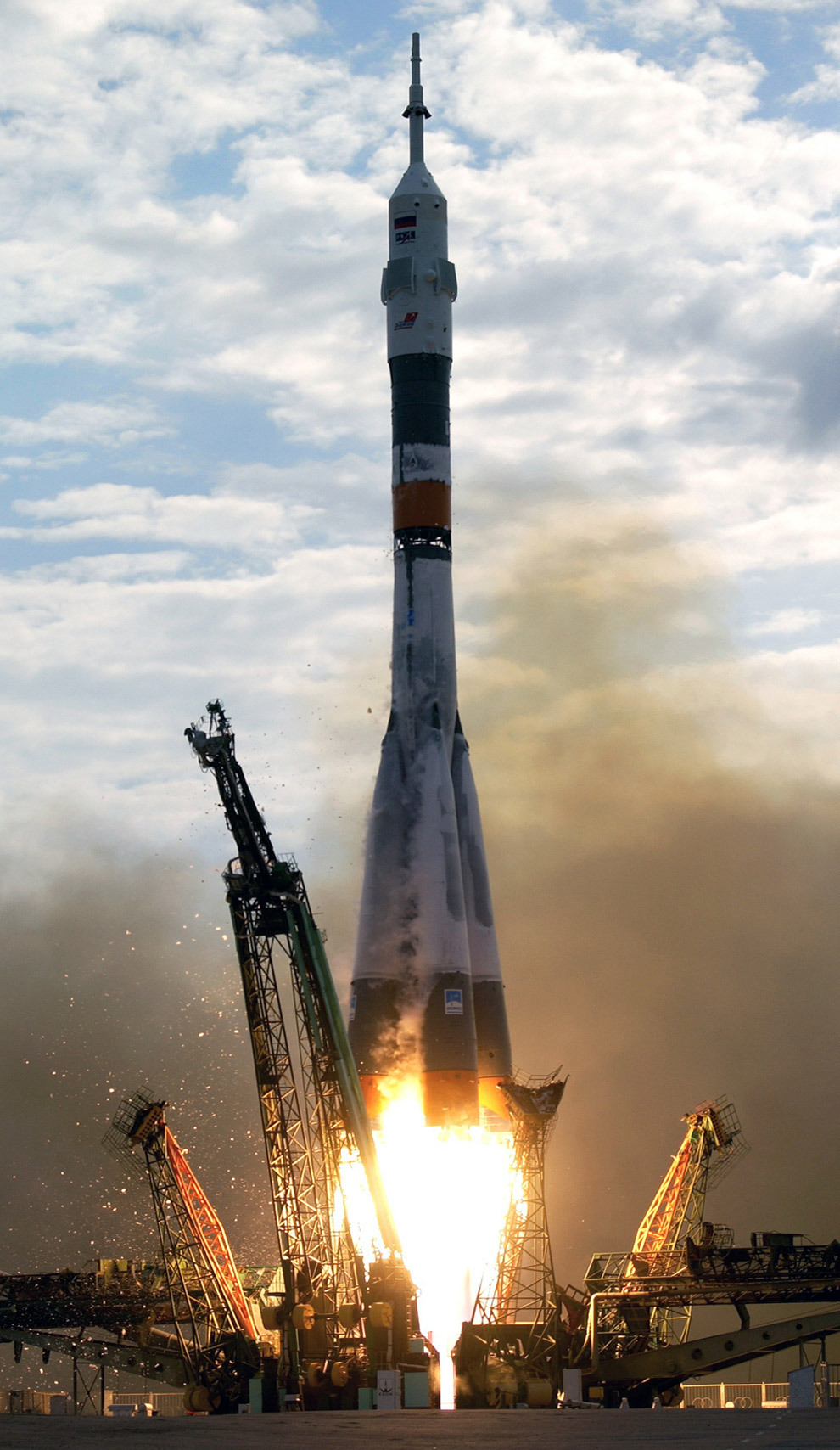 A Soyuz spacecraft lifts off from the Baikonur Cosmodrome, Kazakhstan, at 10:54 p.m. (CDT) on April 26, 2003. Onboard were cosmonaut Yuri I. Malenchenko, Expedition Seven mission commander, and astronaut Edward T. Lu, NASA ISS science officer and flight engineer. Malenchenko represents Rosaviakosmos. (NASA/Scott Andrews)