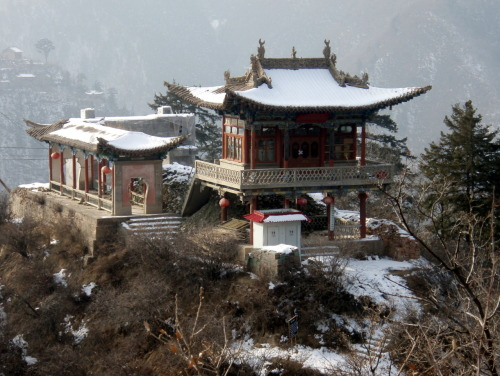 Snowy temple on Xinlong mountain, China