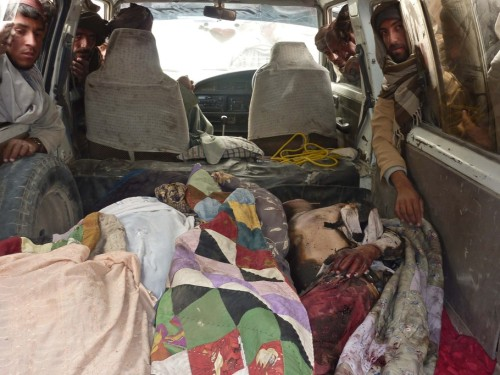 "The bodies of Afghan civilians allegedly shot by a rogue US soldier are pictured in the back of a van in Alkozai village of Panjwayi district, Kandahar province on March 11, 2012. An AFP reporter counted 16 bodies — including women and children — in three Afghan houses after a rogue US soldier walked out of his base and began shooting civilians early Sunday. NATO's International Security Assistance Force said it had arrested a soldier ""in connection to an incident that resulted in Afghan casualties in Kandahar province"", without giving a figure for the dead or wounded. AFP PHOTO/ MAMOON DURRANI"