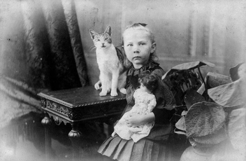Hulda Lundager with her cat and her doll, Mt. Morgan by State Library of Queensland, Australia on Flickr.