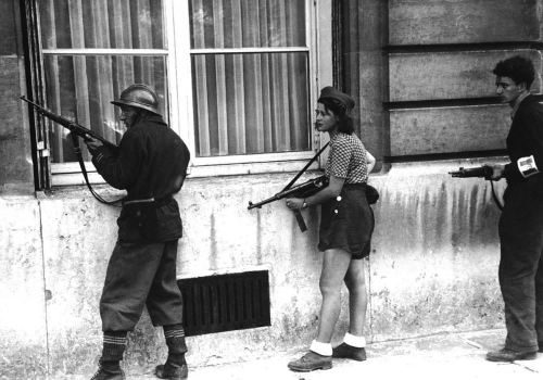 seafaringgypsy:  During World War 2 in 1944, members of the French resistance are photographed in the midst of battle against German troops. I wonder if Rush has ever picked up a weapon to defend his nation like the woman (slut) pictured above. No? Didn't think so.  Bad ass woman!!!