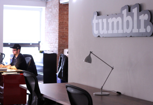 "bdenney:  smcdermott:  Wait a second mashable:  We took a tour of Tumblr's ""cozy"" two-floor HQ in New York City. Check out their space and learn a bit about the company culture, from their meme wall art to their ping pong table and their kegerator. Thanks for showing us around, Tumblr!   Mashable came down to Tumblr and took some pictures! I managed to stay out of all of them, unlike Sean here :)  Is that the Pixar lamp making a visit to the tumblr offices?"