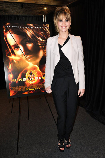 hlangjournal:  SPOTLIGHT.  Jennifer Lawrence touring for her upcoming film The Hunger Games in our SS12 Web Jersey Top.   she needs new hair and makeup people, stat. get Cinna's people.