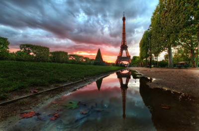 Reflections on the Eiffel Tower by Stuck in Customs on Flickr.