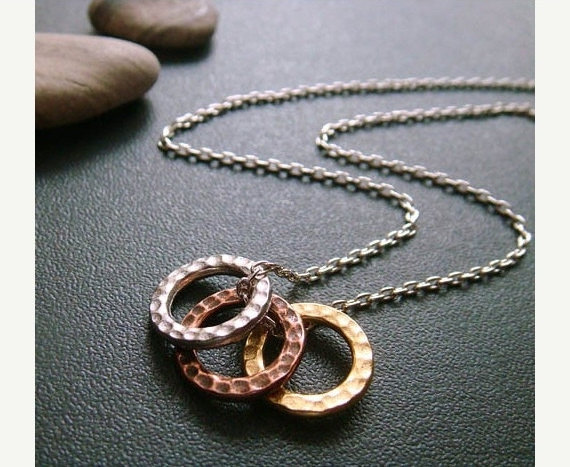 Get hammered…the stylish way of course. Here's a tricolor hammered circle charm necklace you'll be able to snatch up at lili&gen! A set of hammered fine pewter hoops  in silver, aged copper and gold hang from a delicate silver chain, designed by Tryst. I love mixing metals when it comes to accessories and I see this simple yet edgy necklace working well with any outfit. ~lili