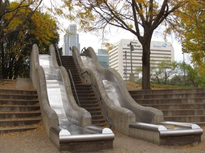 creatingaquietmind:  Stair slides in downtown Omaha  画  These need to be everywhere.
