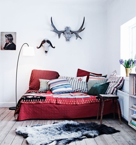 Antlers done right constructionbritannia:  We love the eclectic look of this reading room! It features a great mix of patterns with subdued yet saturated tones. And take a look at the unique accessories!