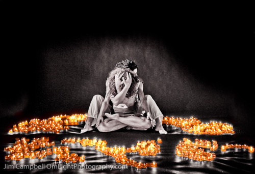 Yoga friends connecting in a sea of fire. See more at OmLight Photography.