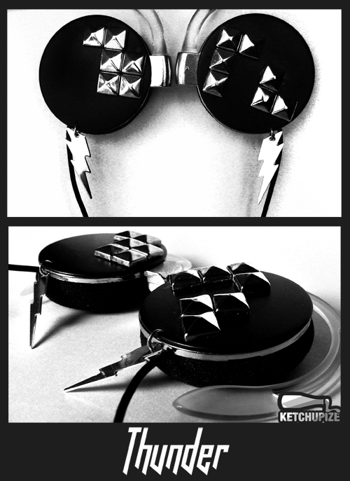 """Thunder"" studded headphones My latest design features shiny pyramid studs and charms on hand painted headphones. Go go rockers ;)More info/available at www.ketchupize.etsy.com"