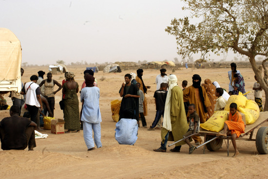 "doctorswithoutborders:  Burkina Faso: Assistance to Refugees from Mali in the North  In the wake of violent clashes between Mali's army and Tuareg rebels, nearly 20,000 Malians have fled their country and taken refuge in northern Burkina Faso. Most of the refugees are gathered in Oudalan, Seno and Soum Provinces. Doctors Without Borders is distributing water and food and assessing basic health care needs in the Mentao camp, which is near Djibo and which is now hosting 3,000 people, up from 1,000 people three weeks ago.  ""There has been a significant increase in the refugee population, and we are expecting to have 5,000 to 10,000 people in this camp in the coming weeks,"" says Jean Hereu, MSF's head of mission in Burkina Faso.  MSF is distributing 50 cubic metres of water per day in Mentao. The teams are also providing food, having initially donated five tons of rice, red beans and oil, with more to come pending the start of an emergency response by the World Food Program (WFP). In the coming days, the teams will assess the medical needs of the refugees with Burkina Faso's Ministry of Health. Photo:Burkina Faso © 2012 MSF MSF carried out a food distribution for Malian refugees in the Mentao camp in northern Burkina Faso."