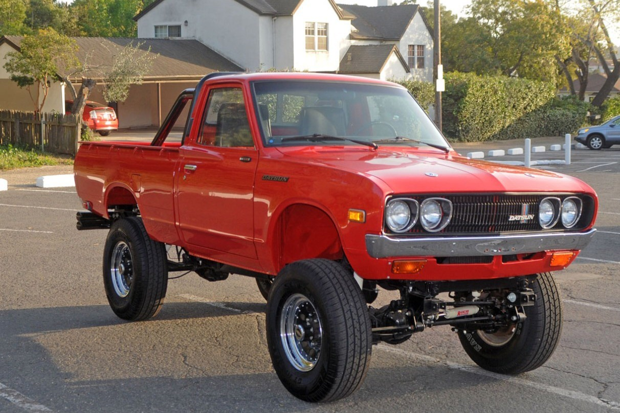 "HNG: 1975 Datsun 620 Pickup Truck w/Buick Small Block V8  ""This is an amazing truck based on a perfect 1975 Datsun pick up {never needs to be smogged}, this truck has been transformed in to something very special. The engine is the legendary all aluminium 215 small block Buick which is fitted with Holley Projection electronic fuel injection. The engine has been properly built and sounds fantastic. The Dual transmission and transfer case is equally trick it features a Hurst shifter, with a Dana 44 rear end and a Dana 30 front end. This spectacular machine is finished in Dupont Imron paint everywhere and the underneath is as clean as the top. It's a detail away from being show ready and could not be duplicated for 3 times our reserve. This very special machine is only for sale due to a change of direction so is very reasonably reserved… inspections and test drives are welcome and all questions will be happily answered…. We will ship any in the world but if sold in the state of California we are obligated to collect tax and license fees….""  (vía Carscoop)"