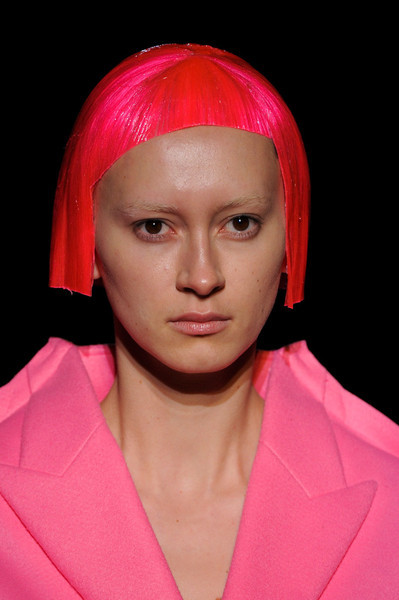 Comme des Garçons / Fall 2012 RTW see the complete runway photos —>http://missbehavecutie.blogspot.com/ She looked like a rocket ready to take off. What followed were variations of this stretched-out flat looking silhouette on jackets, pants, and shorts in vivid reds, aquas, polka dots, florals and camo prints. Shapes were stretched and distorted. Long Nguyen is the co-founder and style director of Flaunt.
