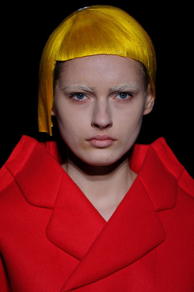 Comme des Garçons / Fall 2012 RTW see the complete runway photos —>http://missbehavecutie.blogspot.com/ There was something cartoonish about the rigid and robotic way the models walked that removed any connection between them and the clothes. It was almost like they were paper dolls, the two-dimensional clothes hooked onto their shoulders. Long Nguyen is the co-founder and style director of Flaunt.