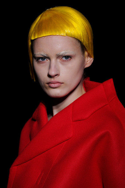 Comme des Garçons / Fall 2012 RTW see the complete runway photos —>http://missbehavecutie.blogspot.com/    A click of one look to the next is like how a child would paste different garments onto a mannequin's body (remember that computer program Cher uses to pick out her outfits inClueless?). That's one way of looking at this show.   Long Nguyen is the co-founder and style director of Flaunt.
