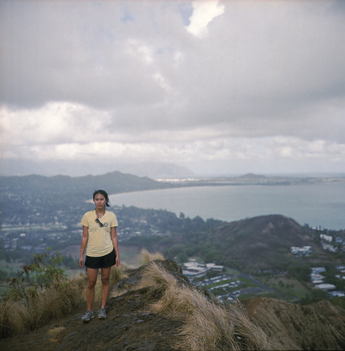 muddy pillboxes // kailua, HI // rolleiflex 2.8e it started pouring while we were chilling on the pillboxes… totally sucked running down with a camera under your shirt slipping off what used to be dirt steps. felt more like wet puddy. after a couple minutes, i told des to stop so i could get a shot of her. forget the rain.