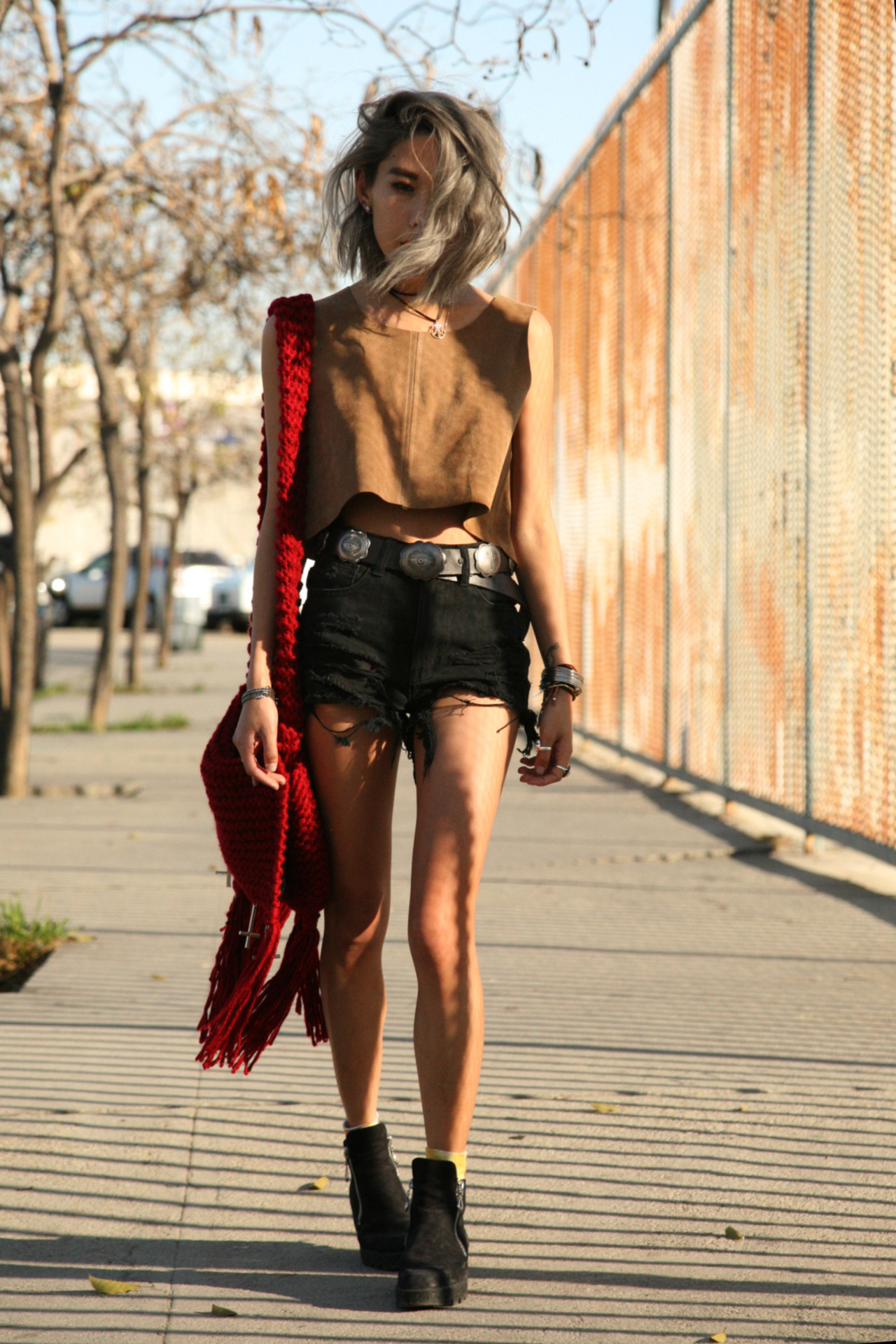 AGAIN Johhny suede crop HERE // UNIF Guess What shorts HERE or HERE orHERE//UNIF concho belt //UNIF Relic Bag HERE //Vintage boots // Tiedye socks from Tokyo UNIF Guess What shorts (image: christeric)