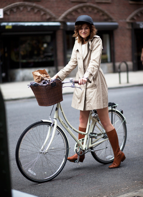 Finally! A cute-girl-on-a-bike shot where she's actually wearing a helmet. However — it looks much too loose. If you pretend to sneeze and the helmet moves at all, you need to tighten it. I had a really nasty bike accident when I was nine and the doc said that a properly-fitting helmet saved me from major damage. (Thanks, parents!) (via streetsmarts)