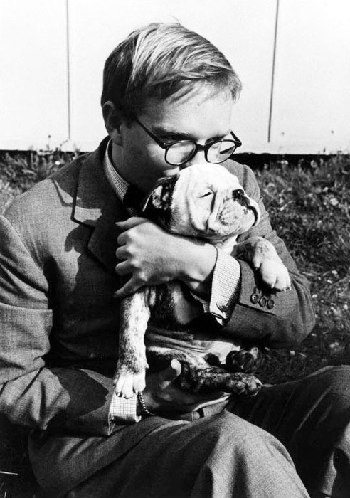 Truman Capote and his bulldog being real in 1953