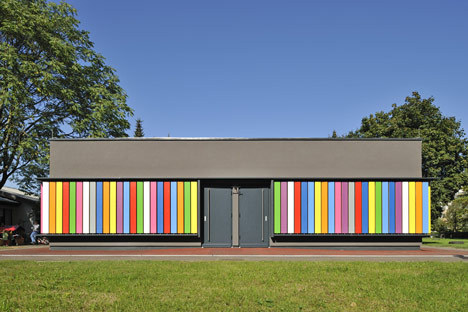 Kindergarten Kekec by Arhitektura Jure Kotnik The building features unique rotating vertical shutters painted in bright colors on one side and plain wood on the other. The design concept derives from the existing kindergarten's lack of play equipment. Ljubljana, Slovenia