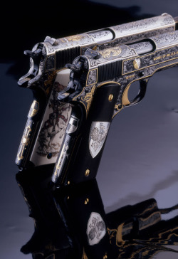 dvorets:  The White and Black Knights, two US Colt M1911 A1 .45 Autos engraved by Mike Dubber.