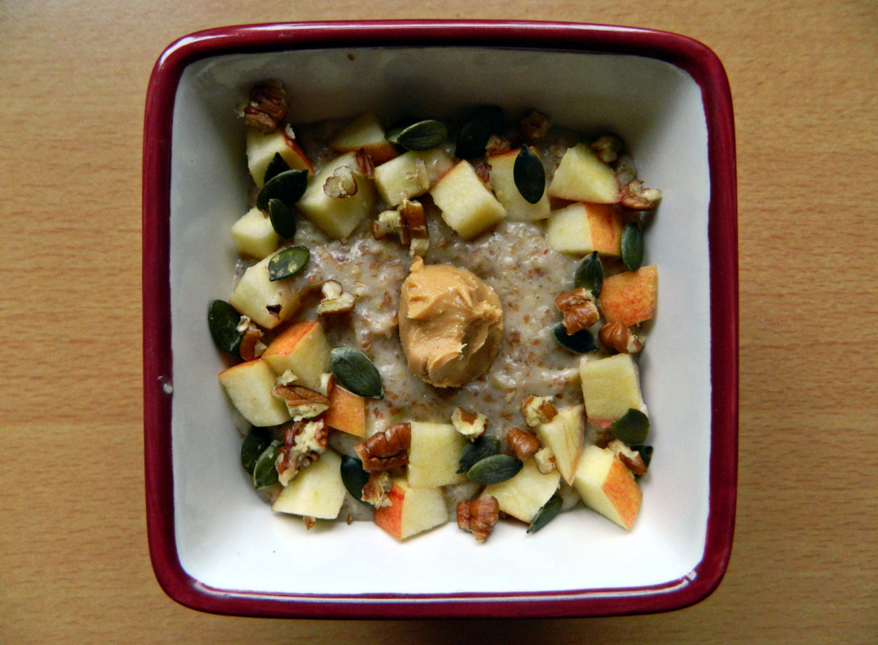 Apple Pie Peanut Butter Oatmeal. -1/3 cup oats, 1/2 a small diced apple, 1 cup unsweetened almond milk, dash of vanilla, 1 tsp agave, 3 shakes of cinnamon, 1/2 tbsp flaxseed (optional). Stir everything together in the saucepan, except for the flax, adding at the last minute to thicken up. If you don't have flax, then simply cook a little longer. Top with the remaining 1/2 an apple, pumpkin seeds, crushed pecans and 1 tsp peanut butter. Yum!