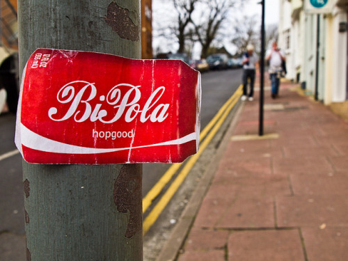 "BiPola hopgood…Coca-Cola pastiche on Flickr.Anyone know what this sticker is all about?   ""BiPola Hopgood"" via the Coca-Cola logo"