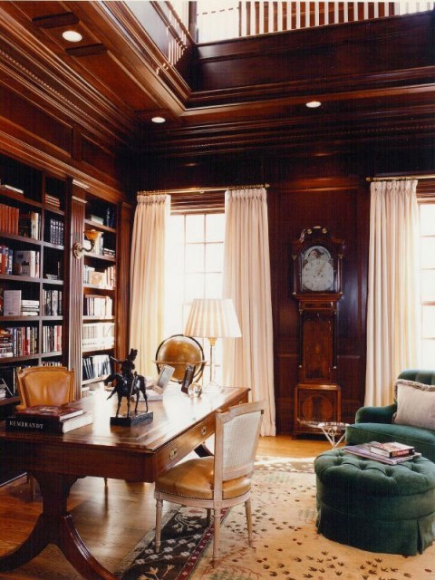The always classic wood-paneled library Just looking again at the photo, they did not miss a trick here… the leather desk chairs, antique desk, comfy chair and hassock for reading, even a vintage globe. This is a room to relax in. (via Brown Davis Interiors)