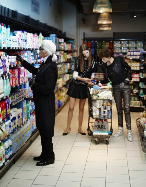 """In the latest issue of French Elle, Karl is seen doing things we all see as normal, but are totally alien to Karl. He says:""""It's the first time I've stepped into a supermarket. It's crazy — fascinating what one can buy. There's enough here to easily gain 20 kilos."""" In the issue (out Friday) he will be seen doing things such as buying stain remover, sitting behind the wheel of a car in a traffic jam and reading a sports magazine. The shoot of course also features his new line, Karl."""
