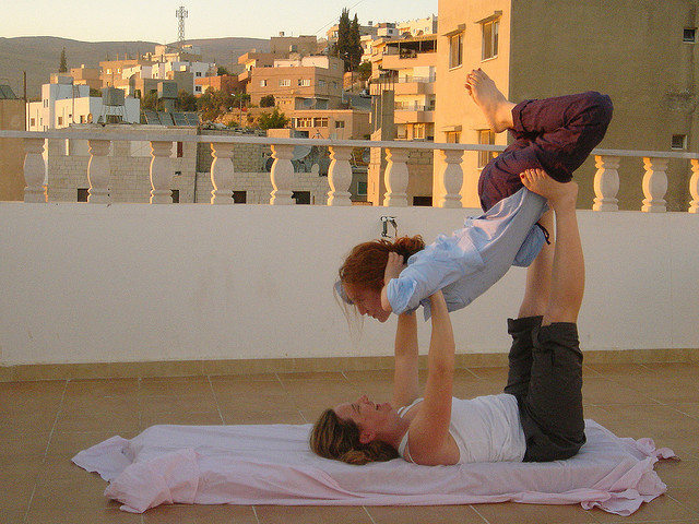 rotterdamblues:  Ruth and Erin doing acro yoga on the roof in Petra by Moira Burke on Flickr.