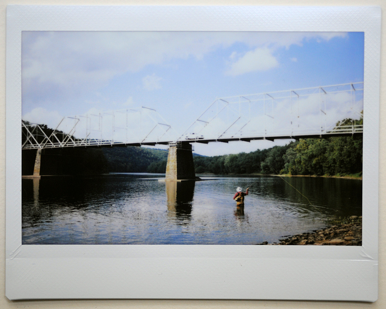 Photo of a photo. Fuji Instax camera, Delaware River, New Jersey side, unknown flyfisherman.