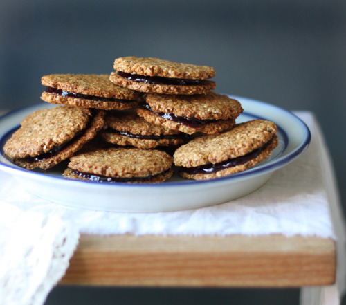 noraleah:  Almond Butter & Jam Sandwich Cookies For my GFF.* * Gluten-Free Friend.   Nora knows me so well. Man, I LOVE a sandwich cookie, but and this one combines almond butter and is inherently gluten-free?!? Bless her heart. I ate a lot of peanut butter and jam sandwiches as a kid; not because I was picky, but because I just loved them. - excerpted from recipe author Sarah Britton of My New Roots
