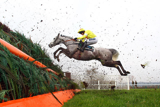 Al Ferof ridden by Ruby Walsh jumps a fence in the Racing Post Arkle Challenge Trophy Steeple Chase run during day one of the Cheltenham Festival in Cheltenham, England. (Julian Finney/Getty Images)