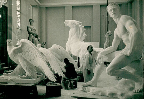 vorgestern:  Arno Breker in his studio, dwarfed by his magnificent sculptures.