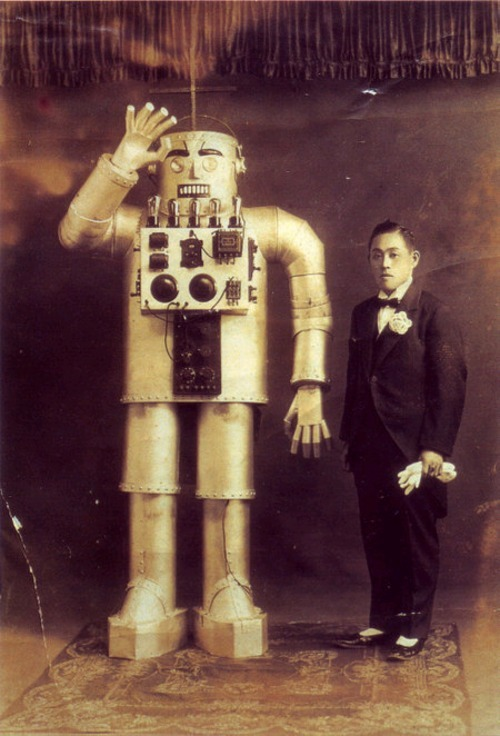 Japan's first robot buddy cop movie, a silent film released in 1919, was shown only once, to an assembly of wealthy land owners in Tokyo. When the film ended, the audience demand for affordable giant robots to work their fields and control the peasants was so insistent, emperor Hirohito had the only copy of the film impounded and destroyed to prevent the idea from capturing the public's imagination. Today, this photo is all that remains of the film's existence. Even the title of the movie has been lost to history.