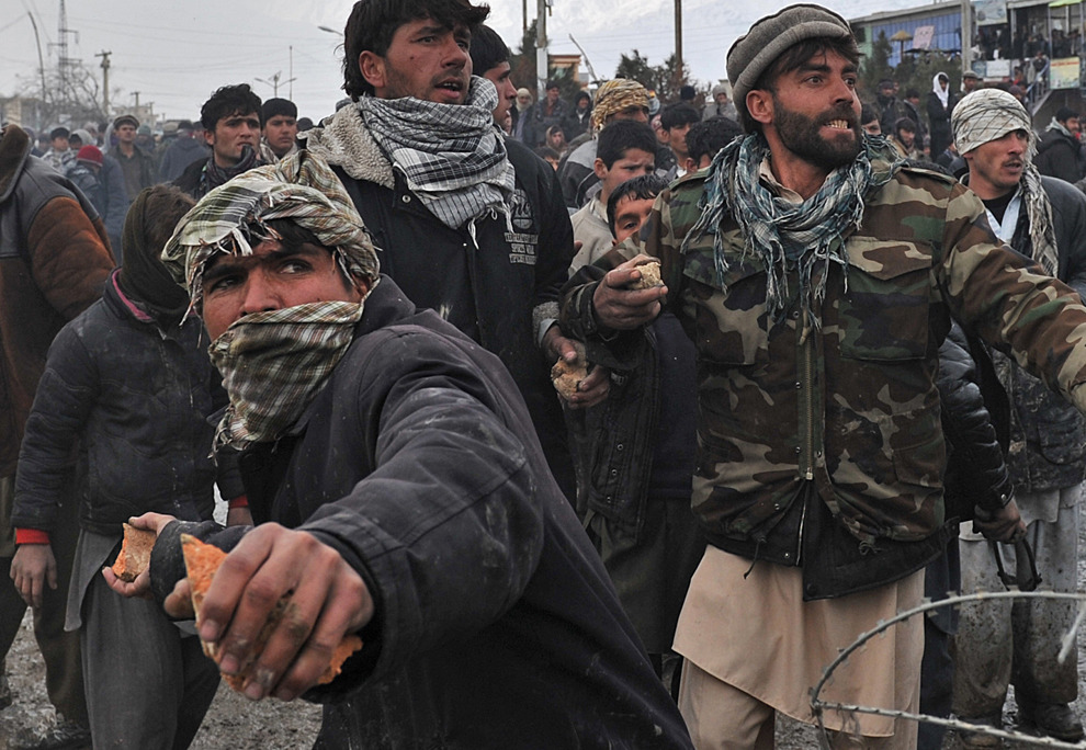 THE BIG PICTURE Afghanistan: February 2012  - February was a violent month in Afghanistan and harsher than usual winter weather added to the misery. (48 photos total)