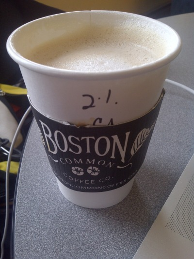 I'm usually satisfied by a latte from Boston Common Coffee, but my drink today is pretty seriously under par. The problem is in the milk. I watched the barista steam it. He set the pitcher down under the steam wand, turned it on, and walked away while the milk made a horrific screaming noise that happens when not enough air is added. Now, I'm forced to drink hot, flat milk. And it is hot— it burned my tongue, and it tastes scorched. If I wasn't in desperate need of caffeine, I would throw it away. My blueberry oat crumble bar, on the other hand? That is delicious.