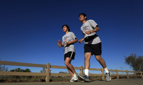latimes:  He will run 26.2 miles in L.A. and not see it: Christian Alvarado, who is blind, will rely on his guide, training and instincts in the L.A. Marathon on Sunday. He took up running, though he didn't like it, to prove a disability couldn't stop him. Photo: Tania Gongora, left, guides Christian Alvarado, who is blind, during a run around the Sepulveda Basin Recreation Area while training for the upcoming Los Angeles Marathon. Credit: Rick Loomis / Los Angeles Times