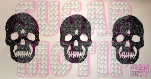 Completed black diamante encrusted skulls on a large canvas. 12 hours of solid work, neck, shoulder and wrist ache!! lol