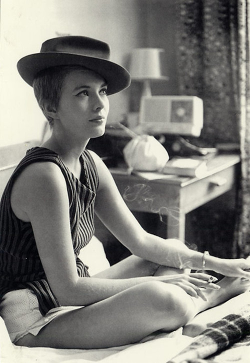 "grapnel:  Jean Seberg"" wearing a hat and smoking in a scene from Godard's ""Breathless (À bout de souffle)"" - 1960."