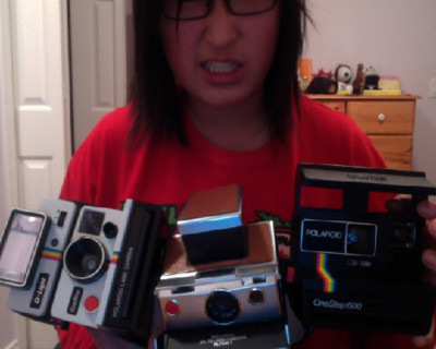 perfectplacetostart:  POLAROID CAMERA GIVEAWAY I'm trying to win a contest on Facebook, so in order to do so, I need your help! In return, I am giving away a Polaroid Camera! Regardless of what happens in the contest, I will give away a One Step, but if I win the contest, I will choose two winners and send out a Polaroid One Step and a Polaroid One Step 600 to two lucky winners!  Rules: To enter, you have to like this photo!  Reblog this post or share the link on Facebook as many times as you want! The deadline is March 25th, 2012  I will ship worldwide  The winner(s) will be chosen at random and messaged over Facebook.  I know this has nothing to do with my blog but I really want a polaroid camera, soooo.