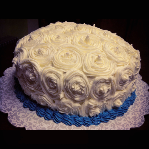Delicious chocolate cake :-). I love the swirls.. easily dresses up a cake.