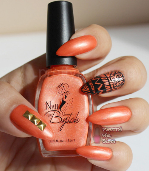 Nail the B.Y.T.C.H. - Pretty Slick Bytch The name of this colour alone sold me! Kept it simple with the tribal and studded accent nails.