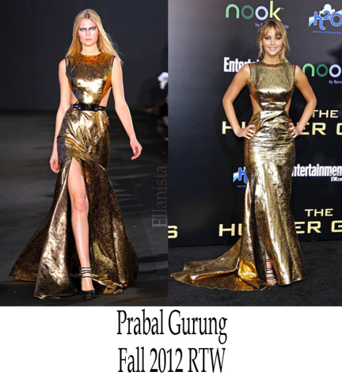 Red Carpet Fashion Jennifer Lawrence looks statuesque in a gold Prabal Gurung dress and Jimmy Choo shoes to the premiere of 'The Hunger Games' at Nokia Theatre in Los Angeles.
