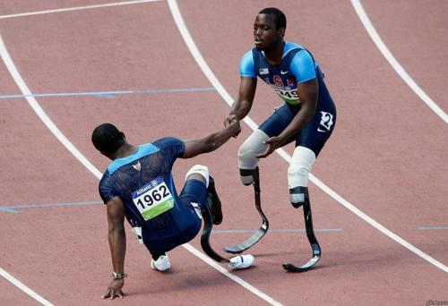 The most inspiring picture ever, I believe it was the 2008 Beijing Games and the guy gave up the race to help another   why doesn't this have a million notes? this is actually amazing.  AMAZING AND SO INSPIRING<3