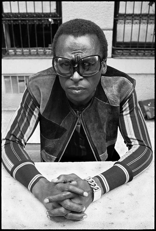 Miles Davis (above) during the shoot for Rolling Stone magazine's cover photo (below):