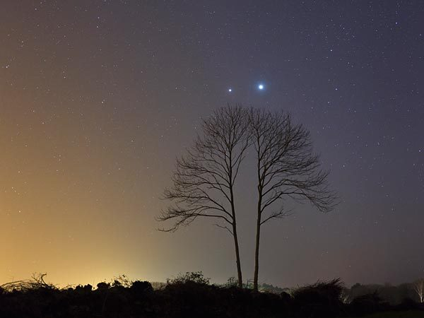 "ratak-monodosico:  The Venus and Jupiter conjunction is seen from France this week. Photograph by Laurent Laveder, TWAN Andrew Fazekas for National Geographic News Published March 13, 2012  This Thursday evening, look to the western skies as Jupiter and Venus—the two brightest planets to the unaided eye—stage a close encounter over the Northern Hemisphere.  Though the two planets will appear to converge all this week, they'll be at their closest March 15—separated by only 3 degrees in the sky, or the width of two fingers at arms' length. When two worlds seem to line up in the sky, it's called a conjunction. But the apparent proximity is an optical illusion—in reality, Venus is nearly 75.9 million miles (122 million kilometers) distant from Earth, and Jupiter sits about seven times farther away at 524 million miles (844 million kilometers) from Earth. Visible throughout the Northern Hemisphere, this week's sky show lasts for more than four hours after sunset, before the planets themselves sink below the horizon. ""While such conjunctions are without any particular scientific value, and we don't believe the planets control our lives any more, they are nevertheless beautiful and easy to see,"" said Geza Gyuk, astronomer at the Adler Planetarium in Chicago, Illinois. In addition, ""what is a bit special about this one is that it is so high up in the sky, away from the setting sun. Mars will also be in the sky on the other side, in the east."" (See ""Sky Show December 1: Jupiter, Venus, Moon Make 'Frown.'"") Close Encounters of the Planet Kind Venus-Jupiter conjunctions are fairly common, according to Gyuk, with the next one occurring on May 28, 2013. During that conjunction, the planets will appear three times closer together than they will this week. ""Another in 2014 will have the two planets come within [a fourth of a] degree of each other, equal to only half the width of the apparent disk of the full moon in the sky,"" Gyuk said. But unlike this week's eye-catching conjunction, the 2013 and 2014 conjunctions will not be ideally placed for Northern Hemisphere observers. (Test your solar system knowledge.) ""We get a reasonably close encounter every two years or so, however the ultimate in conjunctions, when Venus transits in front of Jupiter, happens more rarely,"" he said. The last time such a conjunction occurred was 1818, and it won't happen again until 2065, Gyuk said. One of the leading theories for the Star of Bethlehem legend involves a close conjunction of Jupiter and Venus in the sunset skies in June of 2 B.C. (Related: ""Christmas Star Mystery Continues."") ""Both Jupiter and Venus are very bright objects—the second and third brightest, after the moon—in the night sky, so it's not surprising a conjunction would historically always be watched with interest, simply because both are so bright that they sort of command our attention,"" he said. ""One alone is ignorable, but both Venus and Jupiter together draw the eye.""  (via Venus-Jupiter Conjunction Peaks Thursday—Easy-to-See Sky Show)  🌟✨☺😊😉😍"