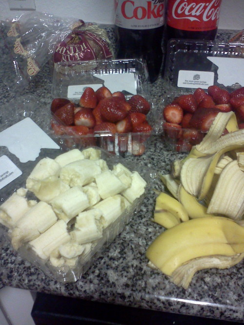 3lbs of strawberries and 1.5 lbs bananas ready for tomorrow's smoothie de-stressor w/ the 4th/5th graders ignore the cokes in the back lol i'm freezing them then getting yogurt and juice to blend with them i hope the babies like it! <3 them
