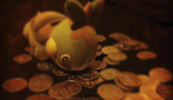 "FEED THE POKéMON Japan is a cash society. This means that in most places of business credit cards are either not accepted or terribly inconvenient to use. Personal checks do not exist here, and traveller's cheques are looked at with much confusion, hand-wringing, and teeth-sucking. It is not uncommon to carry around upwards of 3-Man (30,000 Yen or $300) on your person. If you are, say, walking to the Apple store in Osaka to pick up a new MacBook Pro you will likely have 15—Man ($1500) burning a hole in your pocket. Most progressive, forward-thinking nations (read: not America) have done away with paper currency in small denominations, as it is expensive to produce. One-upping the Euro's 2 Euro coin, Japan's largest coin denomination is 500 Yen. They're rather large and heavy, much more difficult to lose than a quarter. I'm pretty sure I've never lost one or found one on the street. Early into my first year I began a system of saving money with the secondary goal of  discouraging midnight convenience store runs for chicken-mayo rice balls, curry bread, and vending machine sodas. I bought a Pokémon bank for 100 Yen from a local ""recycle shop"" and began following one very simple rule: Any time I return home with a 500 Yen coin in my pocket, I must FEED THE POKéMON. After a year and a half of this, my Pokémon is extremely fat with the weight of 65 of these coins. That's 32,500 Yen ($350 or so). I am told that the Pokémon is a Turtwig #387, but as this number is higher than 151 I haven't bothered to commit this name to memory. If you decide to try the FEED THE POKéMON Method™, I recommend setting a goal item or purpose for the bank ahead of time. I can't think of anything to spend the money on. I keep shaking the coins into the head to make room for more, and now it is next to impossible to keep the Pokémon standing. My no-smoke fund is earmarked for whatever sexy baby the Macbook Pro and Macbook Air lines are in bed right now making, and my rock-and-roll lifestyle does not need much more encouragement. #firstworldproblems"